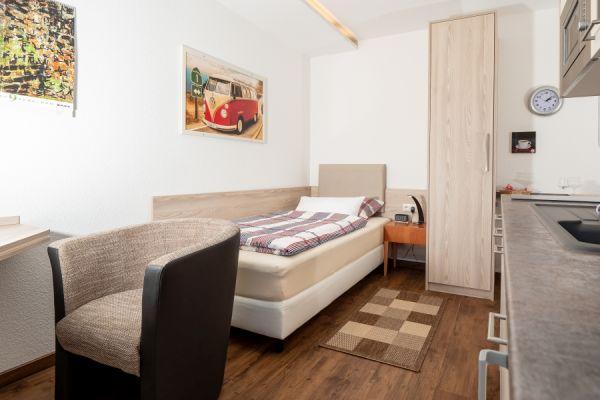 Bett im Apartment Pader
