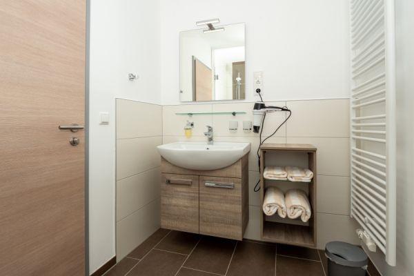 Waschbecken/Bad im Apartment Alme
